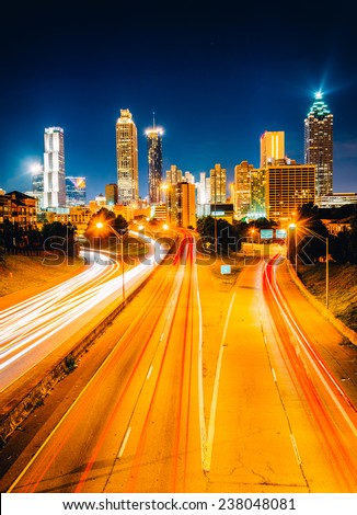 Traffic on Freedom Parkway and the Atlanta skyline at night, seen from the Jackson Street Bridge in Atlanta, Georgia. - stock photo