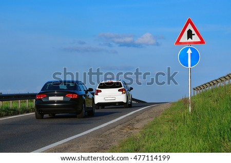 Traffic on highway and road signs