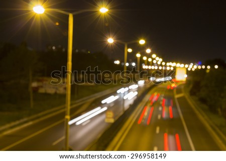 Traffic on highway at night with blurred cars and lights