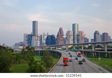 Traffic on highway exiting the City - stock photo