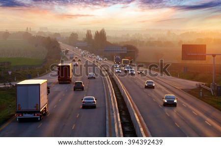 Traffic on highway with cars. - stock photo