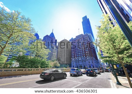 Traffic on JFK boulevard and Penn Center with skyline of skyscrapers in Philadelphia, Pennsylvania, USA. It is a central business district in Philadelphia. - stock photo
