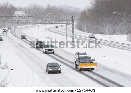 Traffic on the expressway during winter - stock photo
