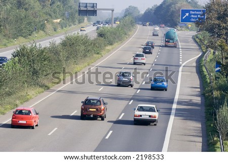 traffic on the highway - autobahn in oberhausen, germany - stock photo
