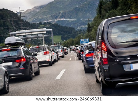 Traffic on the highway. Transportation. pollution, cars, rush hour, vacation, travel and holiday concept. Sitting in traffic on a highway in Switzerland driving home to Lucern - stock photo