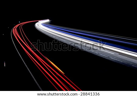 Traffic on the move at night on the M40 motorway in Warwickshire. - stock photo
