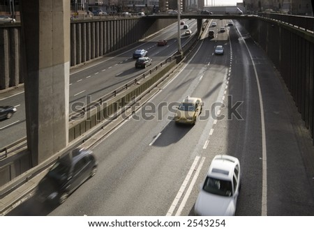Traffic passes along city-centre motorway in the UK - stock photo