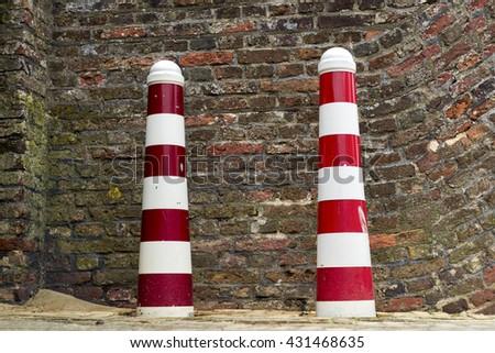 Traffic posts with brick wall bacground - stock photo