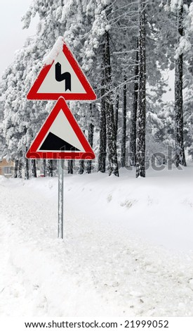 Traffic road sign in frost and snow - stock photo