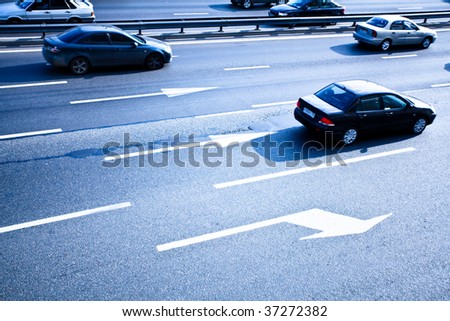 Traffic road with move cars in blue - stock photo