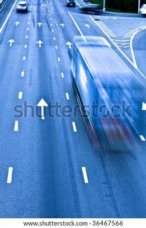Traffic road with truck, motion blur - stock photo