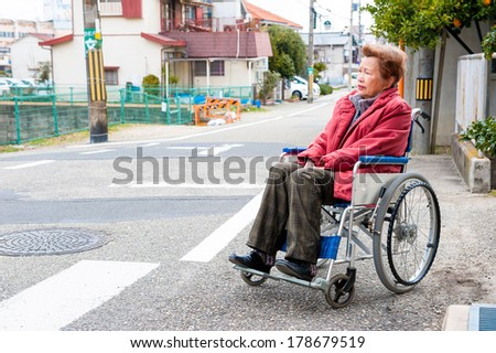 Traffic rules and an elderly woman riding a wheelchair