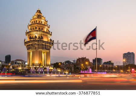 Traffic rush around the Independence monument, with its Khmer architecture style, in Phnom Penh, Cambodia capital city. Blurred motion archived with long exposure. - stock photo
