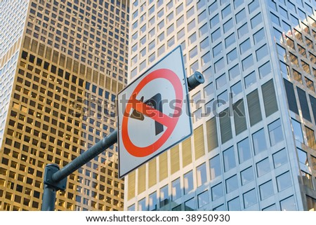 traffic sign before skyscrapers in Los Angeles