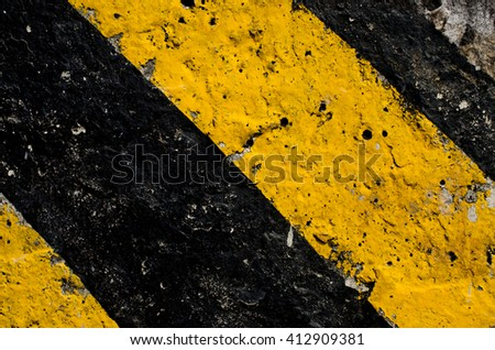 Traffic sign black and yellow color texture background.