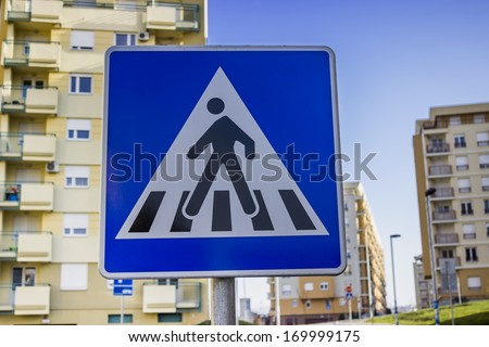 Traffic sign for pedestrian crossing  in a residential area - stock photo