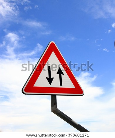 Traffic sign in the sky - two way traffic - stock photo