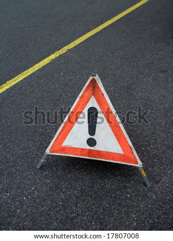 Traffic sign on the road - stock photo