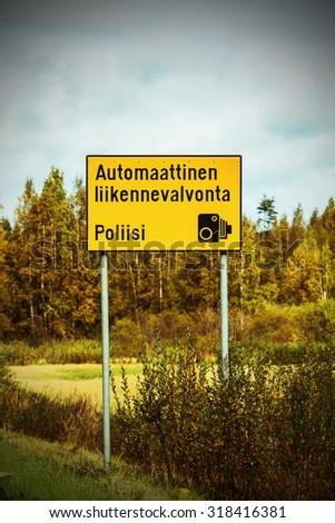 Traffic sign on the road in Finland, which tells the automatic speed control. Image includes a effect. - stock photo