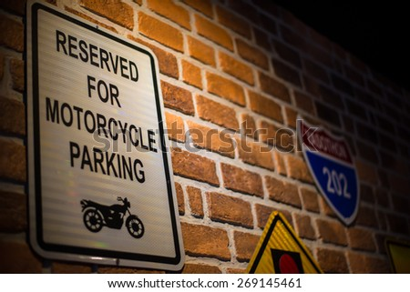 traffic sign on the wall of motorcycle shop. - stock photo