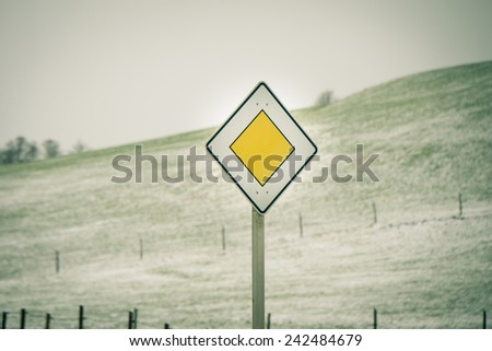 Traffic sign priority road (8), yield, right of way sign,priority road sign - stock photo