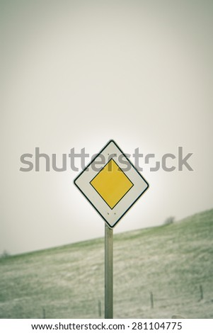 Traffic sign priority road, yield, right of way sign,priority road sign - stock photo