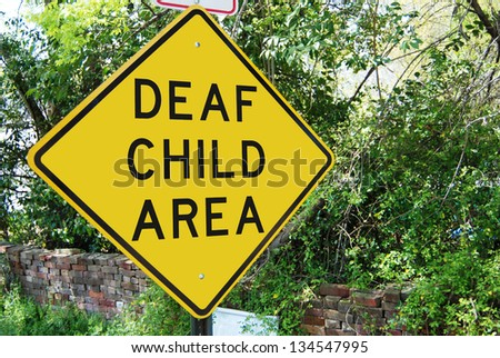"Traffic sign reading ""Deaf Child"" - stock photo"
