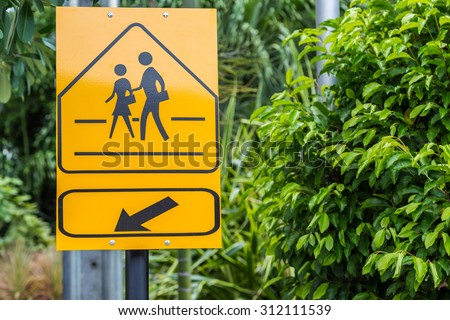 Traffic sign School warning sign here with green leaf background - stock photo