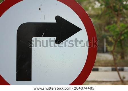 Traffic sign show the turn right on the road. - stock photo