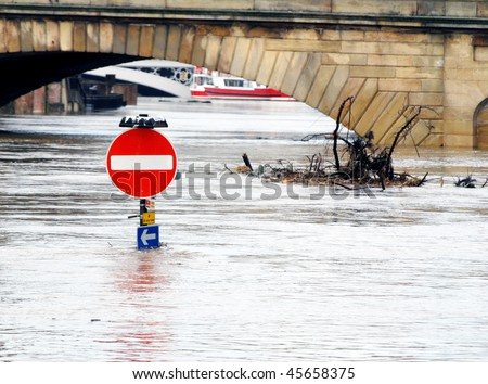 Traffic sign stands underwater during River Ouse floods. York, North Yorkshire, UK. - stock photo