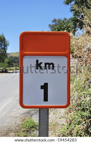 Traffic sign that indicates one kilometer distance from here - stock photo