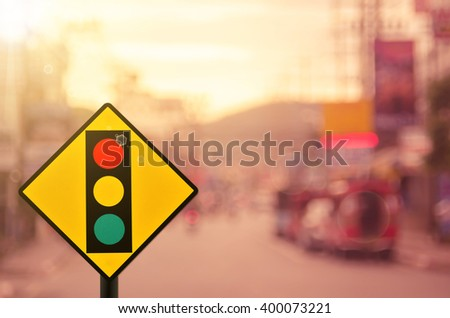 Traffic sign,traffic light sign on blur traffic road abstract background.Retro color style. - stock photo