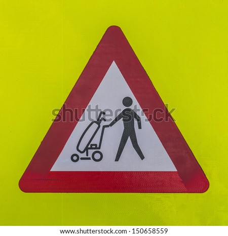 Traffic sign warning for crossing golfers. - stock photo