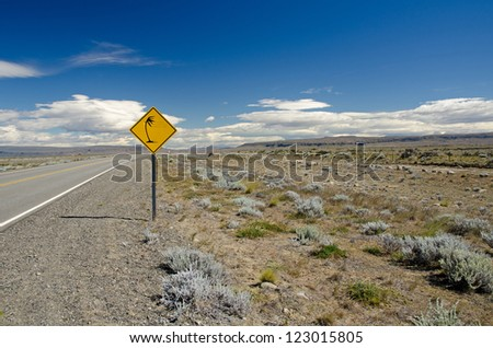 Traffic sign warning of gusty winds on route # 40 near Lago Argentino in Patagonia, Argentina - stock photo