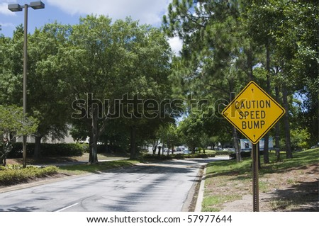 Traffic sign warning of speed bump ahead - stock photo