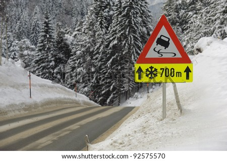 traffic sign warns of snow and ice - stock photo