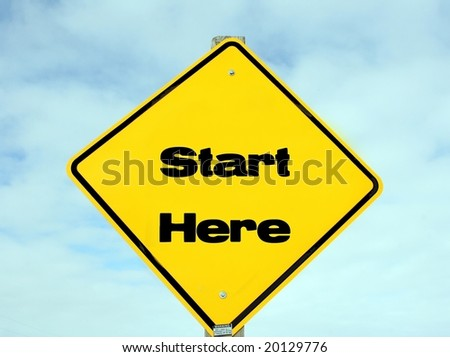 Traffic sign with start here in print