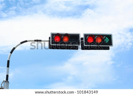 Traffic signal and blue sky - stock photo