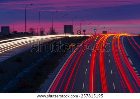 Traffic signals in an spanish road at morning. Night traffic - stock photo