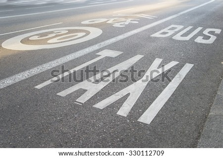 Traffic signs - Bus lanes and parking road markings - stock photo