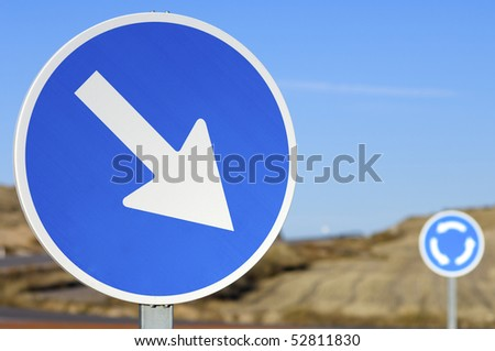 traffic signs in blue round the crossroads - stock photo
