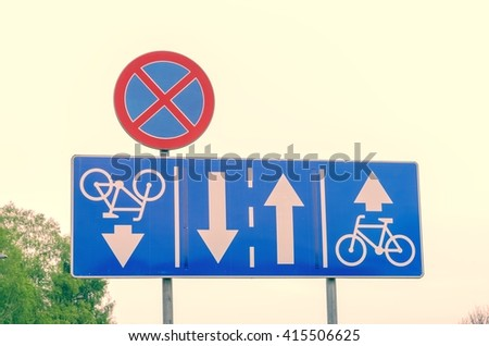 Traffic signs on the street. Road signs for bicycles and no stopping. - stock photo