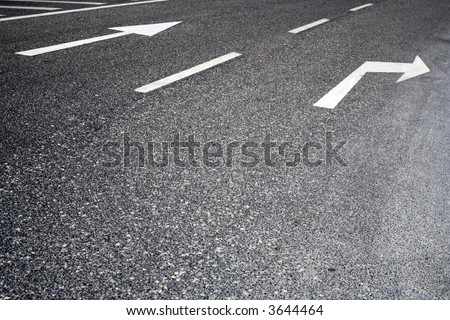 traffic signs painted in asphalt - stock photo