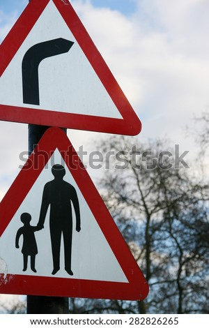 """Traffic signs/warning signs of """"bend to right"""" and """"pedestrians in road"""". - stock photo"""