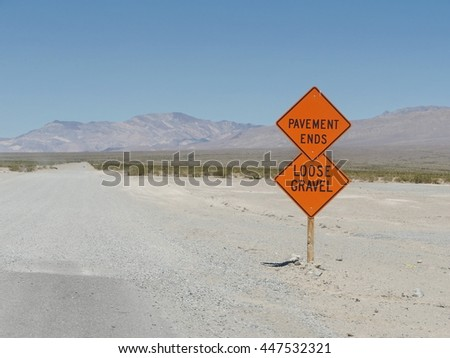 Traffic signs with warnings on road. - stock photo