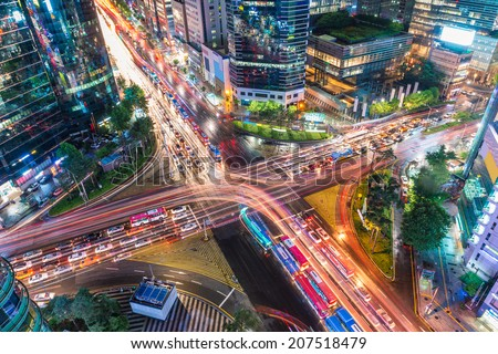 Traffic speeds through an intersection in the Gangnam district of Seoul. - stock photo