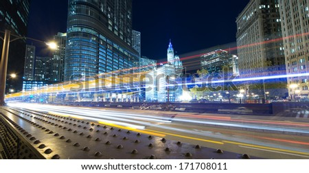 Traffic through Chicago at night - stock photo