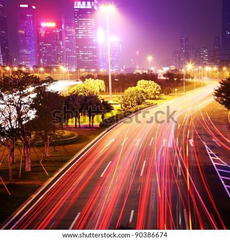 traffic through city at night - stock photo