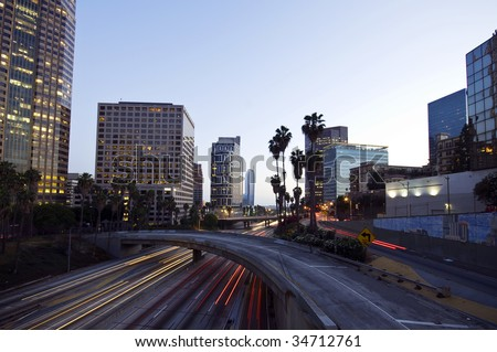 Traffic through downtown - stock photo