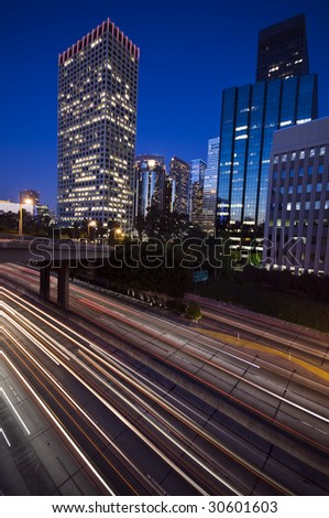 Traffic through downtown Los Angeles at sunset - stock photo